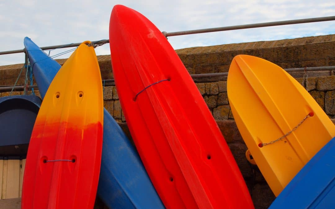 unorganized storage of kayaks and paddle boards in Wilmington