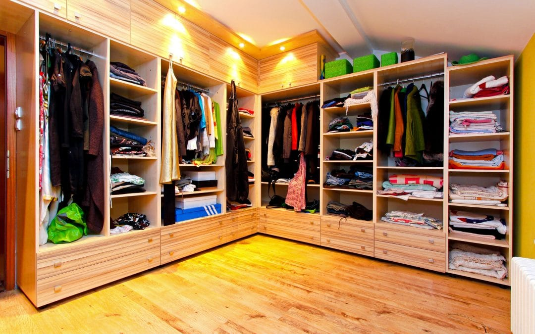 Boutique closet with organized clothes