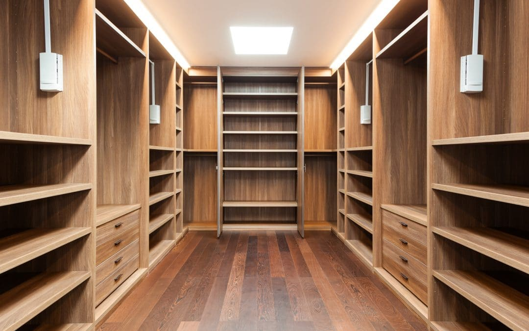 wide wooden dressing room, interior of a modern house with custom drawers, shelves, and hanging rods in Wilmington