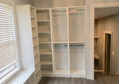 Closet corner organization unit with white shelves for client in Wilmington