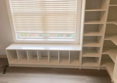 optimal space utilization with storage areas placed under the window with white cubbies in closet in wilmington