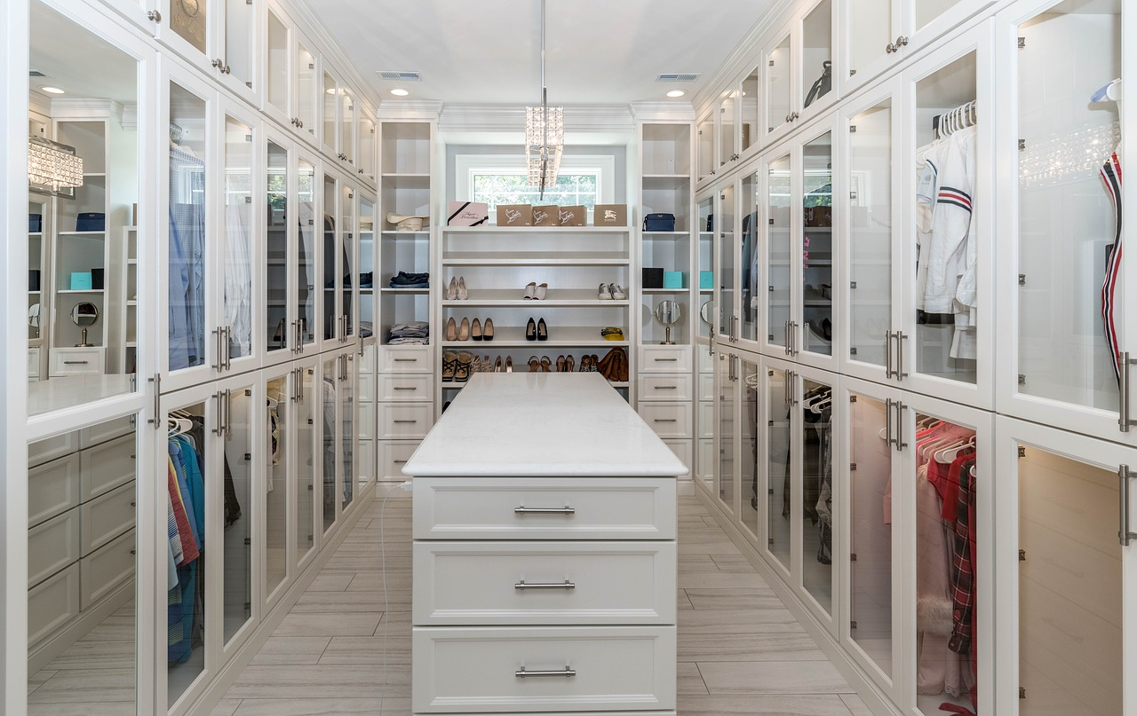 white walk in closet with island in the middle
