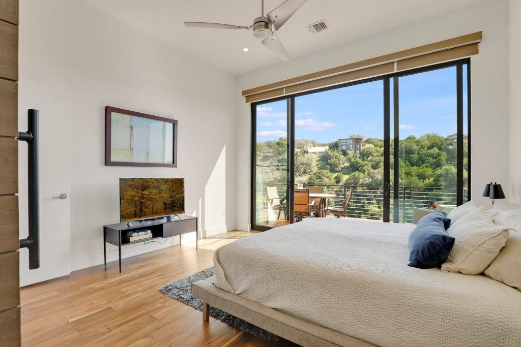 image of bedroom with walk in closet and ceiling fan