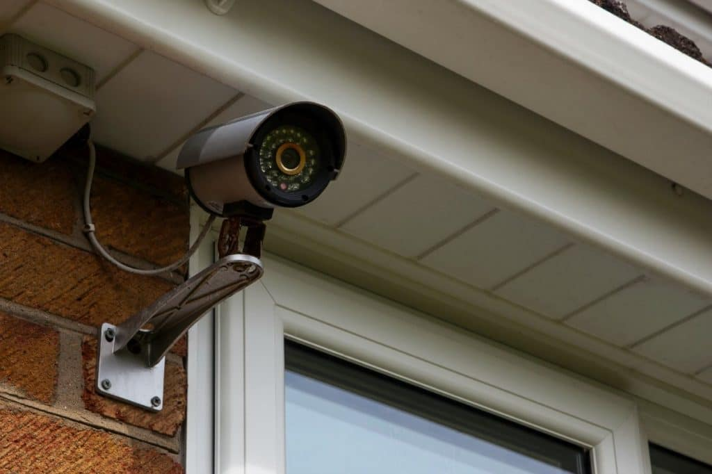 Image of security camera mounted on the outside of a house with custom interior closets