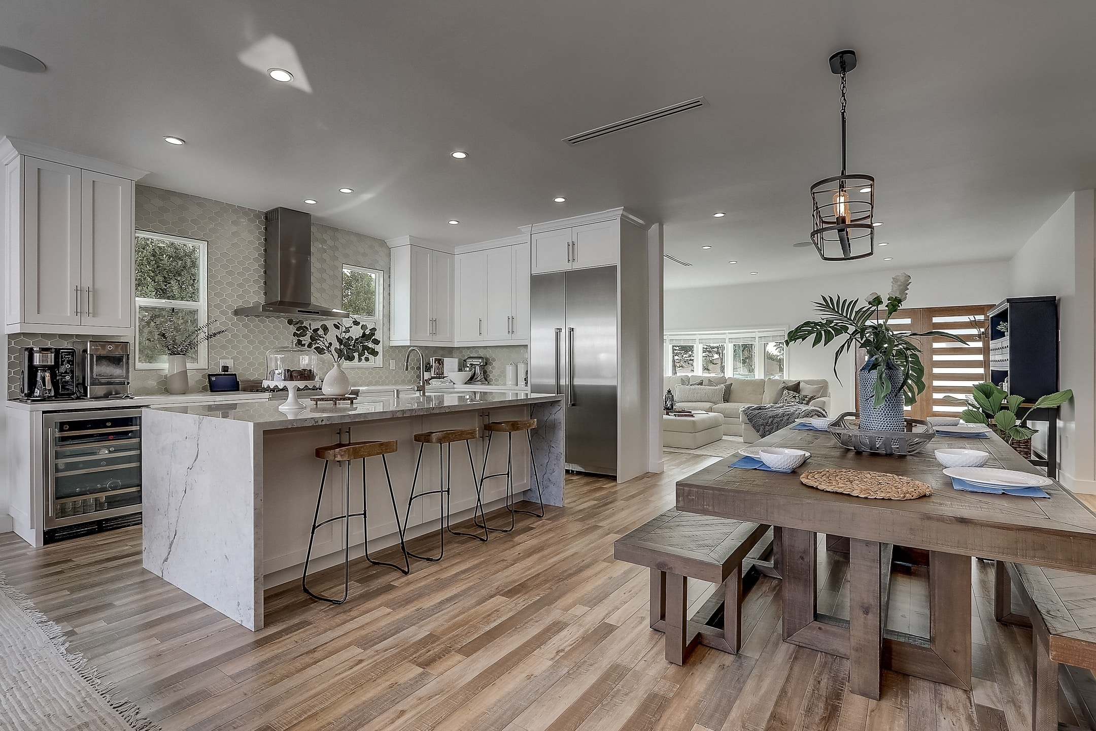 image of a breakfast bar in a house with custom closets in the bedrooms and custom kitchen pantries